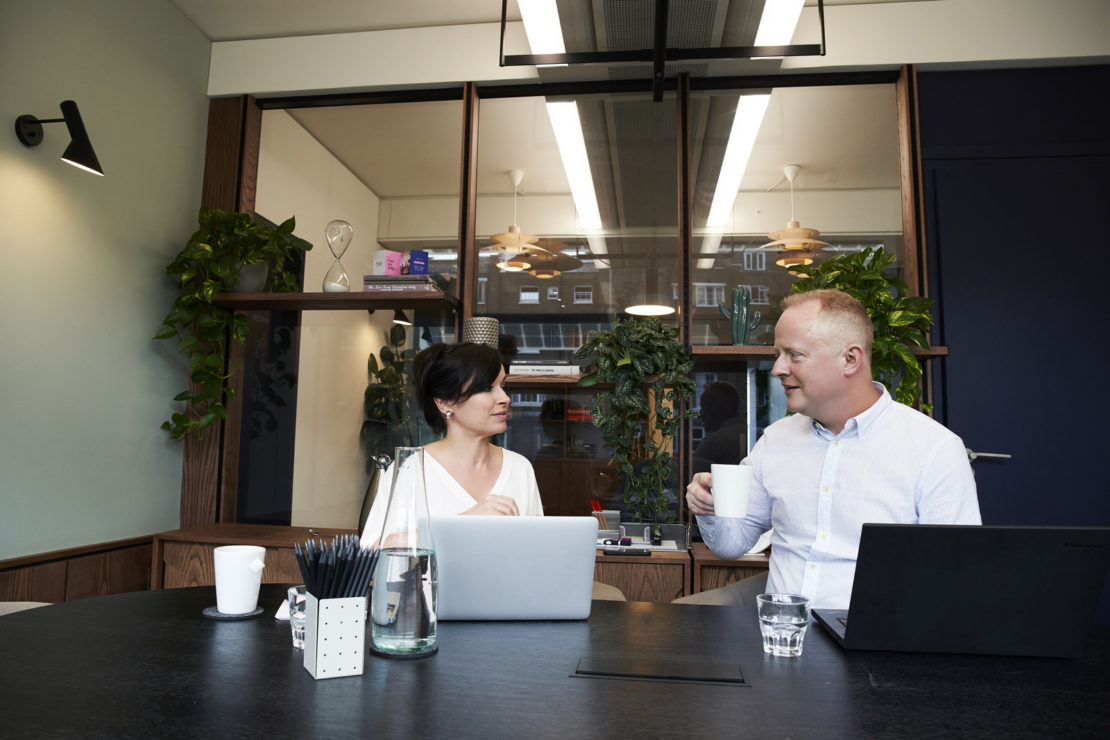Canva - Man and Woman Having a Meeting in the Office4
