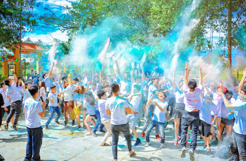 Canva - People Throwing Blue Powder at Daytime