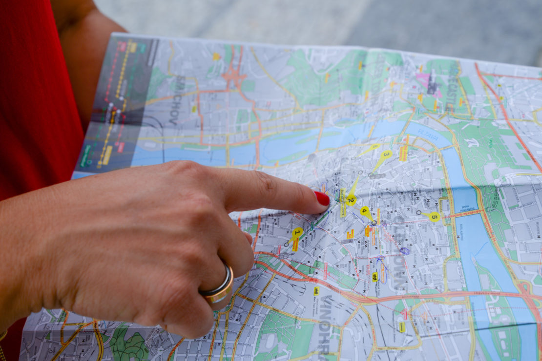 Canva - Person Pointing Map Chart