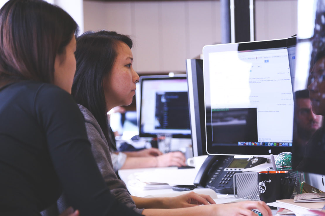 Canva - Two Women Sitting in Front of Computer Monitor4